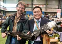 Gary Blakeley and Shelton Chen holding WW2 aerial gun cameras