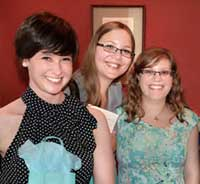 Kaitlan, Shelsie and Danielle at their exhibit of Canadian Composite Photographs