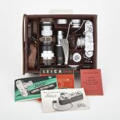 Waddingtons Lot 294, Leica IIIf, five lenses and leather case, plus.