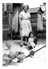 Aunt Lizzie on her farm with my baby sister c1950. I used a Kodak box camera.