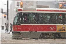 "From Storm 2011 on dfable.com - A TTC ""Red Rocket"" plunging on in a snow storm"